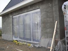 Foto's van Huizen en straten uit Berkel en Rodenrijs - Buitengevel blokken motief