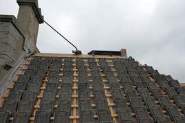 Foto's van Huizen en straten uit Amsterdam - Renovatie daken school Rustenburg in Amsterdam