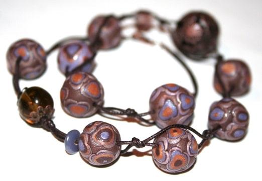 collier fleurs cuivrées